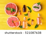 aroma oil with citrus on yellow ... | Shutterstock . vector #521087638