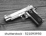 semi automatic handgun lying...   Shutterstock . vector #521093950