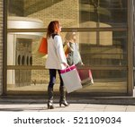 young cheerful woman holding... | Shutterstock . vector #521109034