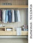 shirts and jackets hanging in...   Shutterstock . vector #521126416