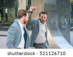 Small photo of American Man with beard, mustache looking at mirror. Man wearing cadet blue suit, standing by metal mirror wall, looking at reflection. Concept of self assured, self esteem, self checking strategies.