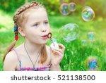 beautiful redhead girl blowing...   Shutterstock . vector #521138500