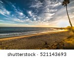 colorful sunset in malibu ... | Shutterstock . vector #521143693
