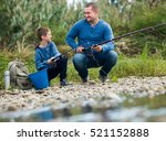 Happy Father And Boy Fishing...