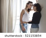 lesbian couple together indoors ... | Shutterstock . vector #521153854