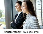 two female collegues standing...   Shutterstock . vector #521158198