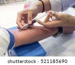 nurse taking real blood samples ... | Shutterstock . vector #521185690