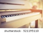 wood piano close up keyboard... | Shutterstock . vector #521195110