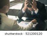 boss scolding a shameful... | Shutterstock . vector #521200120