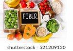 high fiber foods on a wooden... | Shutterstock . vector #521209120