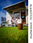 coffee mug on grass. caravan... | Shutterstock . vector #521239978