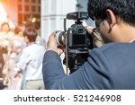 videographer takes video camera ...   Shutterstock . vector #521246908