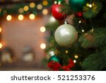 pine branch with christmas balls | Shutterstock . vector #521253376