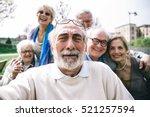 group of senior looking in... | Shutterstock . vector #521257594