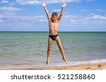 adorable boy jumping on the... | Shutterstock . vector #521258860