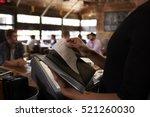 preparing the bill at a... | Shutterstock . vector #521260030
