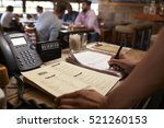 employee at a restaurant... | Shutterstock . vector #521260153
