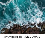 Aerial view of ocean waves and...