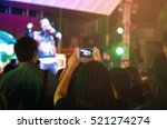 blurred take photo concert in... | Shutterstock . vector #521274274