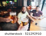 closeup of waiter bringing two... | Shutterstock . vector #521292910