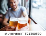 male friends clinking with beer ... | Shutterstock . vector #521300530