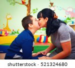 mother kissing her beloved son... | Shutterstock . vector #521324680