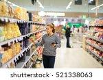 woman shopping in supermarket... | Shutterstock . vector #521338063