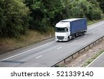 articulated lorry in motion on... | Shutterstock . vector #521339140