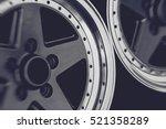 Aluminum metal wheel rim texture. Car alloy wheel, isolated on black background. - stock photo