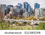 Calgary and its skyline in colorful autumn and fall. Centre Street Bridge over Bow river. Calgarian skyline and skycrapers. Canadian oil city. Stampede city. Cowtown. Alberta. Canada.