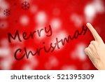 finger writes merry christmas... | Shutterstock . vector #521395309