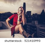 woman at the rooftop wearing a... | Shutterstock . vector #521410993