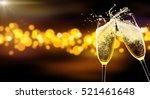 Small photo of Two glasses of champagne over blur spots lights background. Celebration concept, free space for text