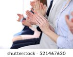 Small photo of Close up of business people hands clapping at conference