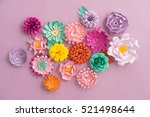 Stock photo colourful handmade paper flowers on pink background 521498644