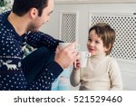 happy dad and son with cups of... | Shutterstock . vector #521529460