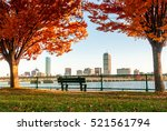 Stock photo boston skyline in autumn viewed from across the river 521561794