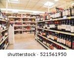 blurred image of wine shelves... | Shutterstock . vector #521561950