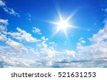 sun in blue sky with cloud | Shutterstock . vector #521631253