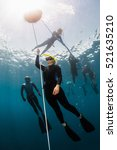 Small photo of Free diver training to ascend along the rope