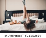 Stock photo beautiful smiling girl year old having fun in bed with breakfast on wooden tray wearing 521663599