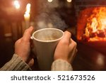 woman's hands with a cup of... | Shutterstock . vector #521673526