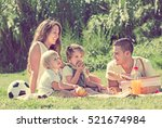 smiling young family of four... | Shutterstock . vector #521674984