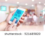 hand holding mobile with health ... | Shutterstock . vector #521685820
