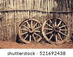 Two Old Wagon Wheels Near The...