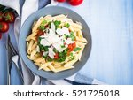 penne pasta with tomato sauce ... | Shutterstock . vector #521725018
