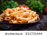 penne pasta with chicken and... | Shutterstock . vector #521731444