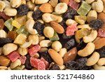 dried fruits and nuts background | Shutterstock . vector #521744860