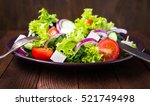 greek salad with lettuce ... | Shutterstock . vector #521749498