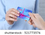 woman giving gift card to... | Shutterstock . vector #521773576